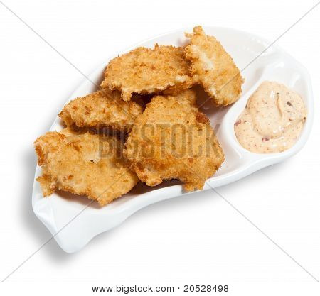Chicken Nuggets With Sauce On The Plate