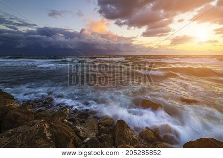 Storm in the sea at sunset. Beautiful seascape.