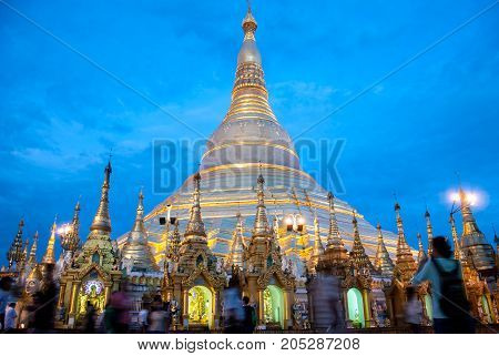 Yangon Myanmar. Sep 9 2017. Myanmer famous sacred place and tourist attraction landmark Shwedagon Paya pagoda illuminated in the evening.