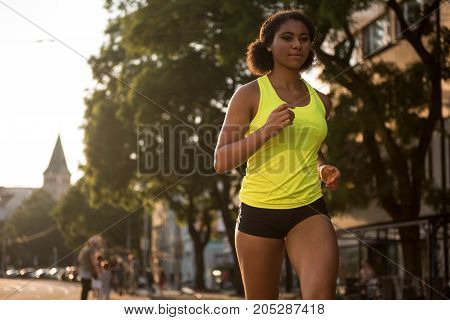 Jogger and fitness sport model training outdoors