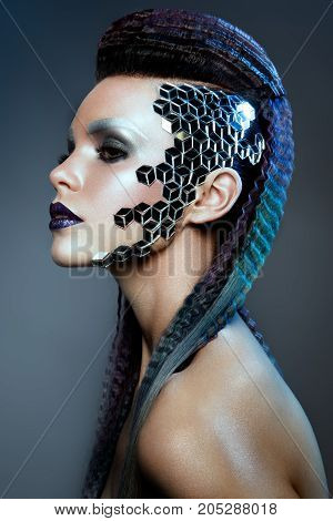 Shot of a futuristic young woman. Blue hair