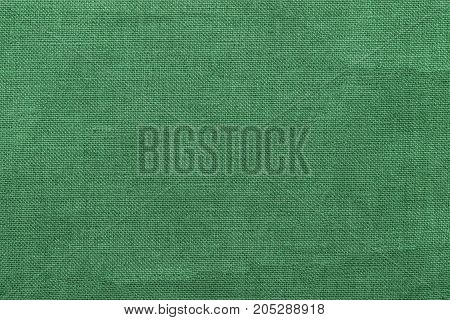 green burlap background and texture, The texture of the burlap, closeup