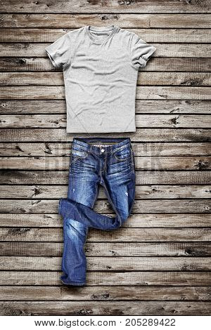BLue jeans trouser and shirt over wood background