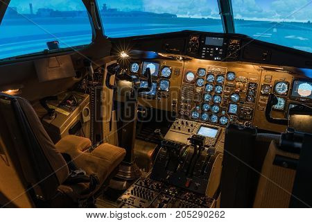 A view of the cockpit of a large commercial airplane a cockpit trainer. Cockpit view of a commercial jaircraft cruising