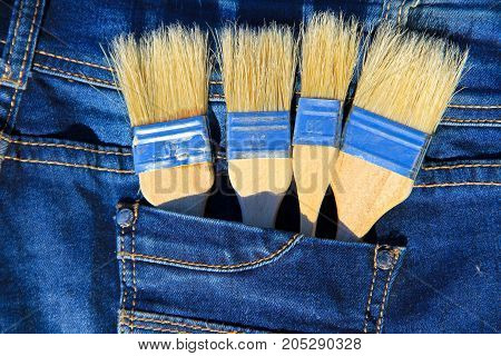 Paintbrush in the pocket of the blue jeans