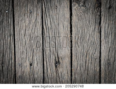 Old  grey wooden texture for background or mockup. Wooden background with darkened edges close up. Barn wall texture. Rustic fence or grey flat wood banner billboard or  signboard.