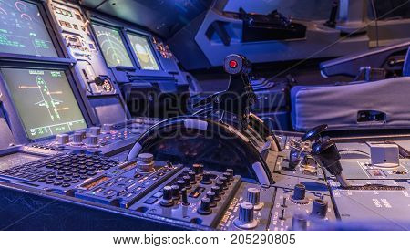 Engine lever in the cockpit of an airliner. Center console and throttles in an airplane