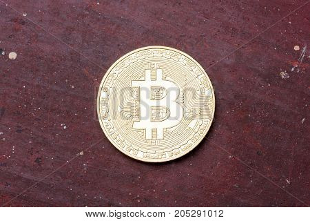 Golden bitcoin on red background, close up. High resolution photo.