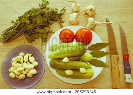 Fresh organic vegetables on table. Include fresh organic vegetables and Cucumber on wooden floor. Green Cucumber garlic - Retro color
