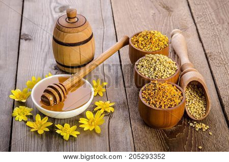 beekeeper's still life with flowers on wooden background