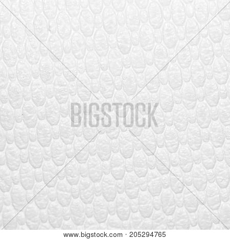 white leather as a background. close-up . Photo as an abstract background