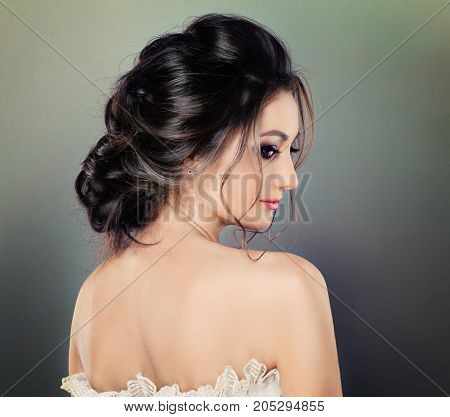 Beautiful Woman with Wedding Hairstyle and Perfect Makeup Fashion Portrait