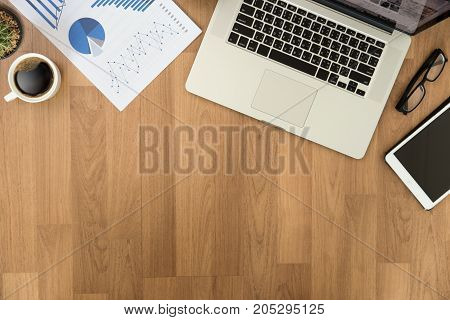 Top View Man Used Of Laptop  Hands On A Wooden Desktop And Copy Space