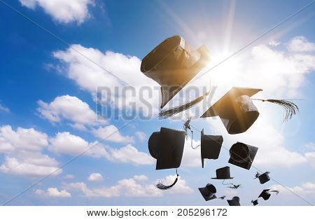 Graduation Ceremony Graduation Caps hat Thrown in the Air with bluesky abstract background.