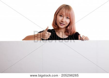 Young Asian Woman Show Thumbs Up With Blank Sign.