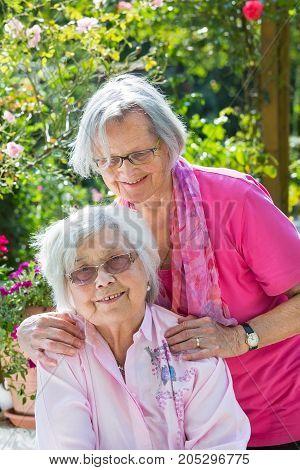 Outdoor Portrait Of Two Senior Female Friends