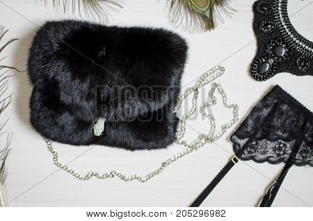 Black And White Women Accessories On The White Backgroud. Lace Garter Belt And Fure Bag. Necklace
