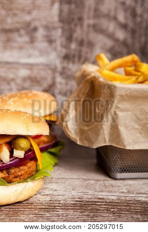 Delicious tasty cheeseburgers on wooden background. Fast and tasty food