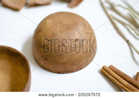 Clay Pottery Isolated. Decorative Dark Brown Ceramics On The White Wooden Table