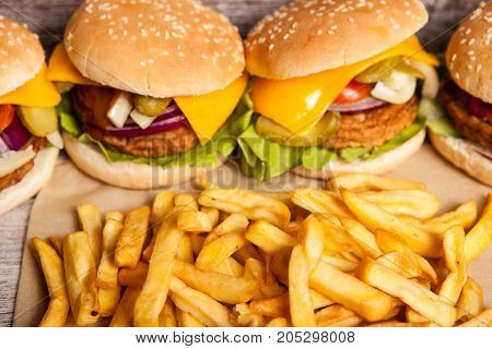 Delicious homemade tasty burgers on wooden background. Fast and tasty food