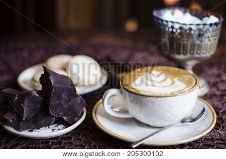 Coffee Breack With Chocolate And Macaroons. Latte On Retro Brown Wooden Table With Tablecloth