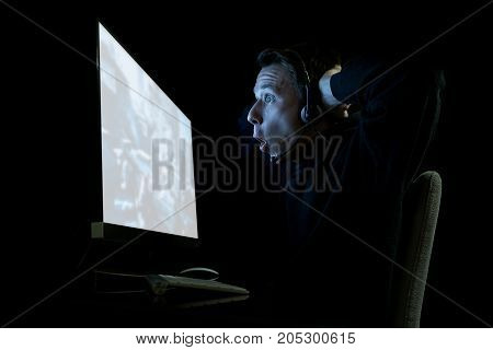 Young Gamer In The Dark