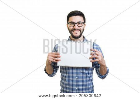 Handsome bearded young man in glasses hold textbook with copy space