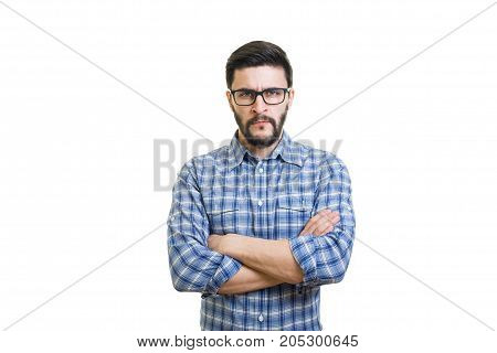 Serious bearded man portrait with rolled sleeves
