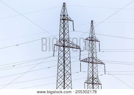 pole for electricity wires . In a park in the nature