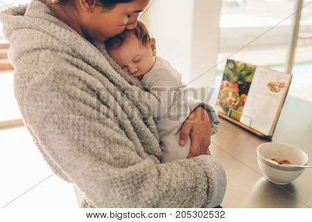 Newborn Baby Boy Sleeping In His Mother's Hands