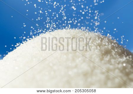 sugar on a blue background . Delicious food in the kitchen