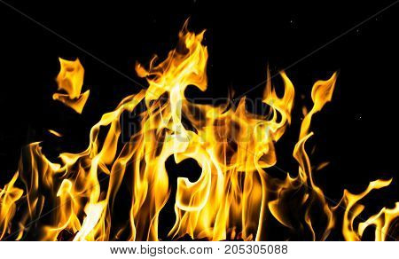 flame fire on black background .  Photo as an abstract background