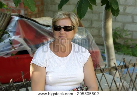 Portrait of a senior woman at backyard