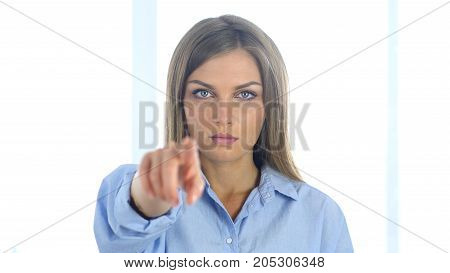 Portrait Of Woman Pointing At Camera In Office