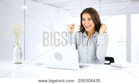 Happy Woman Celebrating Success Of Her Project