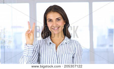 Portrait Of Successful Young Woman Gesturing  Victory Sign