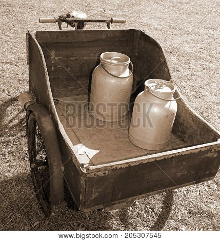 Wooden Cart With Old Bicycle To Transport The Milk Just Leavened