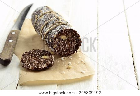 Chocolate dessert Salami sugar-free, vegan, space for text