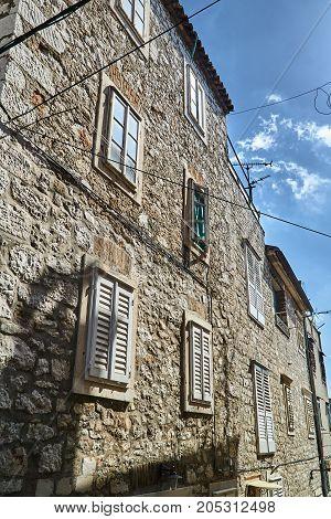 Street with stone tenement houses in Sibenik Croatia