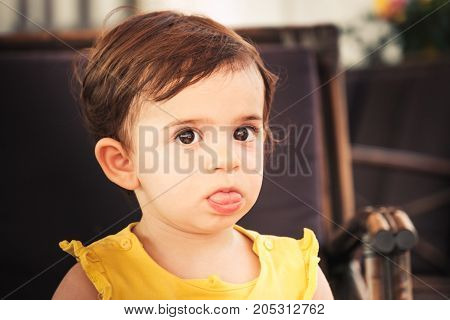 newborn tongue baby child grimacing funny baby