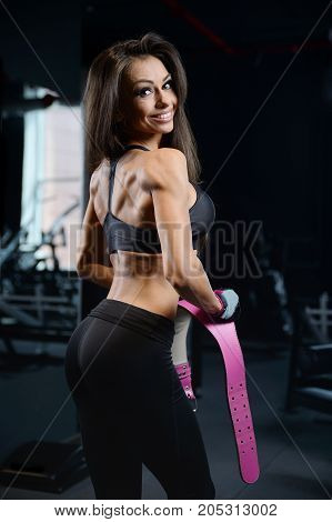 Sexy Athletic Young Girl Training Back In Gym