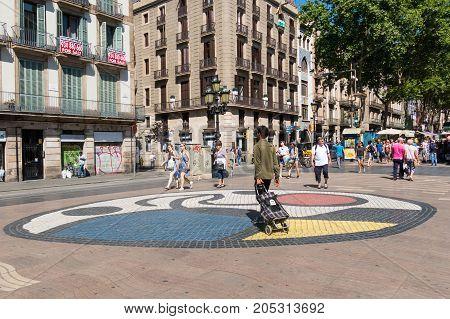 Pavement Mosaic By Joan Miro On La Rambla In Barcelona, Spain