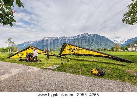 Interlaken Switzerland - May 26 2016: Hang gliding after landing against the background of the Swiss Alps in Interlaken Switzerland.