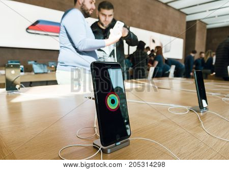 PARIS FRANCE - SEP 22 2017: New iPhone 8 and iPhone 8 Plus as well the updated Apple Watch Apple TV goes on sale today in Apple Store with customers holding admiring the phone