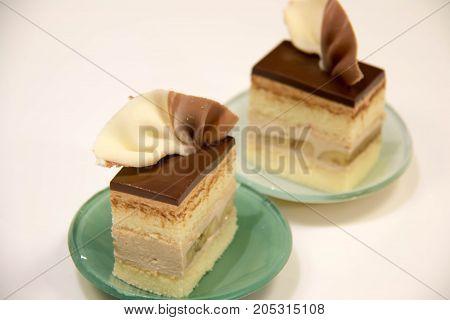 Slice of vanilla cream cake decorate with chocolat