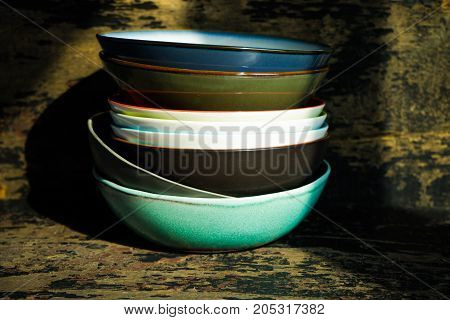 Empty rustic bowl and vintage wooden spoons on old wooden table