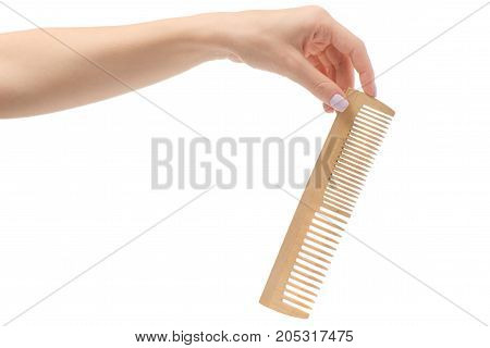 Female hand wooden comb on white background isolation