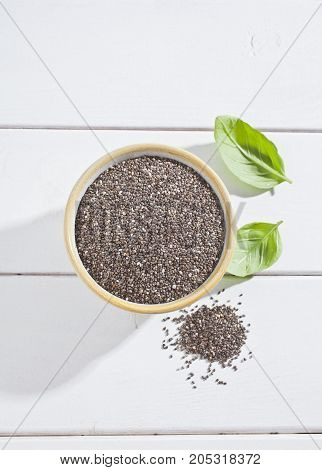 Bowl full of seeds of chia and fund other healthy seeds