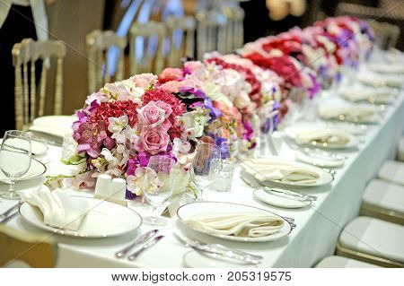 table set and flower for a wedding dinner