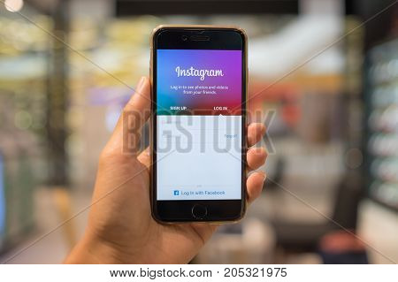 CHIANG MAI THAILAND - SEP 07 2017: A man hand holding iphone with login screen of instagram application. Instagram is largest and most popular photograph social networking.